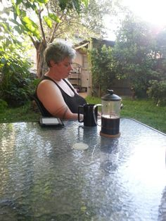 7am Friday. Ange in the garden with coffee