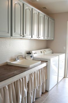 Grand Design: Wash. Dry. Fold. Repeat.  I like the color of cabinets, I need to paint mine or something.