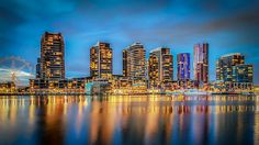 As the sun goes down, the lights come out to play on Waterfront City in Melbourne's Docklands precinct.
