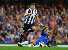 Yohan Cabaye of Newcastle United evades Raul Meireles of Chelsea during the Barclays Premier League match between Chelsea and Newcastle United at Stamford Bridge on August 25, 2012 in London, England