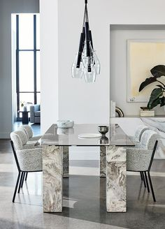 """Marble and glass dining table by Jennifer Fisher steals the scene in sculptural fashion. """"I wanted it to feel like a statement, but not overly heavy, which is why we gave it a glass top. The neutral marble legs lend themselves to any design. Furniture Dining Table, Glass Dining Table, Round Dining Table, Dining Rooms, Coffee Table Cover, Black Napkins, White Bar Stools, Grey Table, Jennifer Fisher"""