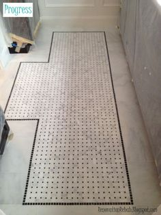 "tile floor mat"" using a combination of basket weave carrara marble tiles and 12""x12"" carrara marble tiles"