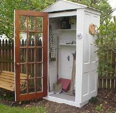 DIY Shed - 11 Designs to Inspire Yours - Bob Vila #olddoors four doors, one roof and sime shelves, as needed. Perfect, fast and simple #outdoor #storage