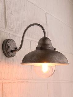 Aged iron wall light
