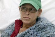 This photo taken Aug. 27, 2013 shows Bev Veals waiting for her chemotherapy treatment at Duke Cancer Center in Durham, N.C. Coping with advanced cancer, Veals was in the hospital for chemo this summer when she got a call that her health plan was shutting down. Then, the substitute coverage she was offered wanted $3,125, on top of premiums. It sounds like one of the insurance horror stories President Barack Obama used to sell his health overhaul to Congress, but Veals wasn't in the clutches…