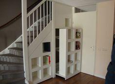 Under stairs storage behind display