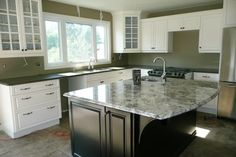 L-shaped Kitchen with Island | the sinks and seamed the quartz on the l shape