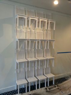 Our chair shelving wall has become a reality - fun.