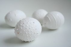Easter eggs with white puffy paint for dimensions. Let dry then decorate with dye, glitter or other paint! *repinned by WonderBaby.org