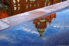 Helsinki, Finland: The Uspenski Cathedral reflected in a puddle on the shore of the canal between the districts of Katajanokka and Kruununhaka.