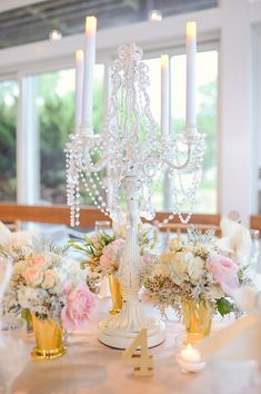 Tall, pearl candle sticks, gold vases , and light pink florals are gorgeous centerpiece ideas for a shabby chic wedding! {Photo courtesy of Kari Rider Events}