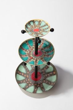 kaleidoscope jewelry stand from urban. could make with pretty decorate plates!