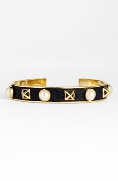 Adore this Rebecca Minkoff piece of arm candy. The faux pearls look gorgeous against the black and gold detail.