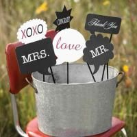 "Word Bubble Photo Booth Prop Set Word bubble prop six-piece set made of paper. Titles include: ""Mr., Mrs., Love, XOXO, Thank You and Cong..."