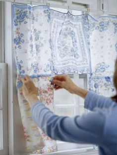 Curtain Construction    Handkerchiefs may not be as practical as they were before the advent of Kleenex, but that's no reason to pitch those pretty fabrics. Sew them together, add rings along the top, and they become an instant, airy curtain!