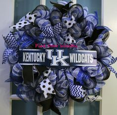 1 Deco Mesh UNIVERSITY OF KENTUCKY UK wreath    Made with blue and white deco mesh and accented with similar colors to accent the UK sign in the