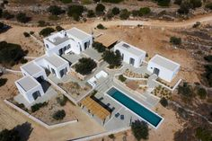 The property is situated in the East part of the island facing Naxos. The plot is a steep olive grove. Earth is retained by dry stone walls which look like threads on the ground looking from above. The concept is to w. Dry Stone, Old Wall, Paros, Maine House, Architect Design, Terrace, Pergola, Stone Walls, Island