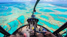 We're not done with Australia just yet... We highly recommend you visit the Great Barrier Reef at least once in your life... But you have to do it from up in the air... The views will leave you breathless!   @lesleyannemurphy as always... #greatbarrierreef #coralsea #queensland  #australia #aerialview #helicopter #ride #intheair #travel #wander #discover #corals #islands #destinationnext by tripstirapp http://ift.tt/1UokkV2
