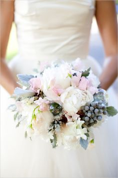 I love the texture and cascading nature of this soft earthy bouquet.  Berries, freesia, sweet peas, #peonies in #sage #white #pink and #green