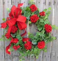 This wreath is perfect to welcome spring and to use all summer long! Extremely realistic true red geranium blooms rest on a bed of geranium leaves