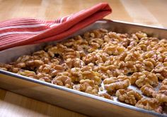 Easy instructions for toasting walnuts and suggestions for recipes featuring toasted walnuts.