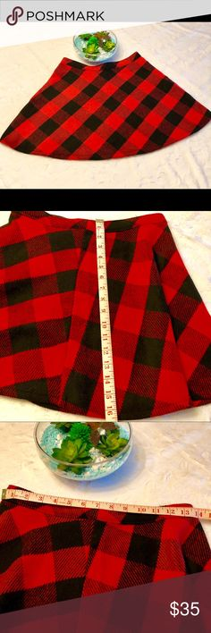 Plaid Skirt by Hollister, size medium Beautiful red and black plaid skirt from Hollister. This preppy skirt is adorable. It can be worn with boots, flats or heels.  It is the perfect skirt for almost any item you chose to wear with it, a sweater, leather coat, button up shirt, etc.  This Skirt was only worn twice and has lots of life left.  It is very gently used.  Measurement are shown in the pictures. Hollister Skirts Mini