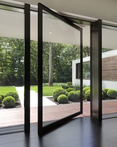Contemporary pivoting front #door leading to the #backyard