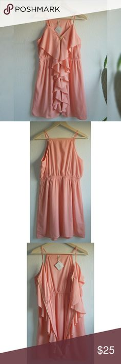 Peach dress with ruffles . V- Neckline with a front zipper with ruffles all the way down. i love this dress from the colors to the desing it Has elastic on waist . Impressions Dresses