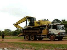 Excavator getting off truck
