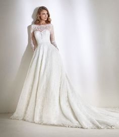 New   Atelier Pronovias   A spectacular princess wedding dress with lace bodice and beaded full skirt.