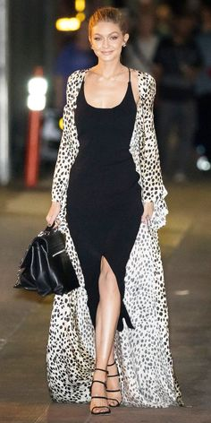 Gigi Hadid Perfectly paired with a slinky LBD and stilettos, Gigi Hadid's statement maxi coat is a convincing argument for wearing more leopard print. Gigi Hadid Looks, Style Gigi Hadid, Mode Outfits, Fashion Outfits, Night Outfits, Fall Outfits, Modelos Fashion, Animal Print Outfits, Black Bodycon Dress