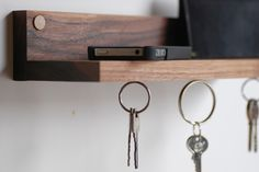 """This wonderful magnetic key holder and shelf is a great way to keep daily essentials organized. Three remarkably strong rare earth magnets are embedded in the under side of the shelf and grab on to key rings with a satisfying """"snap."""" A firm tug releases them when its time to leave the house. Our magnetic key ring holder and shelf easily fits wallets, phones or sunglasses. Wonderful gift idea for guys or housewarming gift idea."""