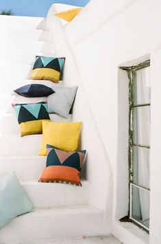 Check out these tropical pillows from Nine Space. 11 Steps to Resort Decor: How to Bring Vacation Vibes Home When You Can't Get Away #resortdecor #colorfulpillows #tropical