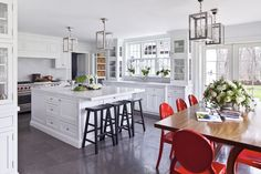 Red kitchen chairs in a white kitchen for a pop of color?  Why not!