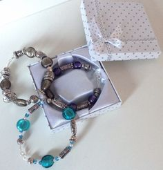 Handmade bracelets (silver and purple/turquoise/bronze), materials from John Lewis. Polkadot jewellery boxes from eBay, these add a nice finishing touch.