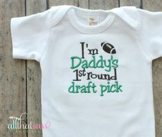Bodysuit is embroidered to read Im Daddys 1st Round Draft Pick in brown and green. Perfect for game day, or every day wear...and not just for