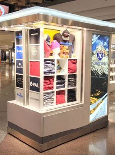 Pop-Up shops: which sells t-shirts from denver-area ski resorts, is the newest kiosk to open at denver international airport. Shop Display Stands, Store Displays, Retail Displays, Merchandising Displays, Window Displays, Display Ideas, Retail Store Design, Retail Shop, Retail Business Ideas