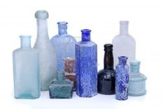 Image detail for -Old antique glass bottles in different colours on a white background ...