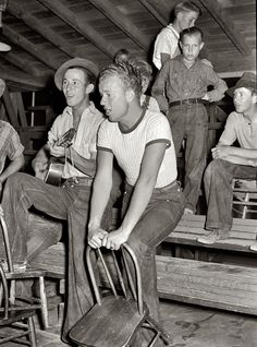Agua Fria: May 1940. Young migratory agricultural workers singing at the Saturday night dance. Agua Fria migratory labor camp, Arizona. Medium format negative by Russell Lee for the Farm Security Administration.