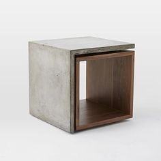 Freddie Side Table #westelm Mixing mediums. The Freddie Side Table pairs cool concrete with a warm walnut veneer, for a modern silhouette that sticks out without getting in the way.