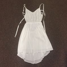 White dress, open back! Never been worn Super cute white dress with open back! Size large Love Culture Dresses Mini