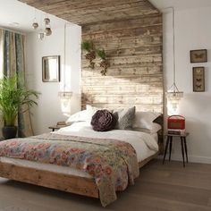 love the collection of colors and textures in this room: reclaimed wood canopy, small chandeliers as bedside lamps