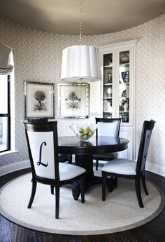 dining room- love the monogram chairs. wallpaper.grey ceiling. Obviously could be way more glam with a new sparkly crystal chandelier :)