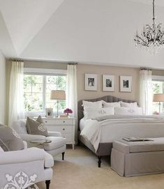 Chic bedroom features a sand colored accent