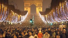 Thousands of revellers celebrate the New Year on the Champs Elysees in Paris.