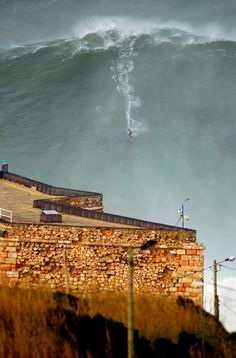 Portugal is one of the best SURFING destinations. Garrett McNamara surfing a  wave at Praia do Norte, Nazaré, Portugal Photo: Tó Mané