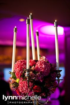modern pink wedding, beautiful pink floral arrangement centerpiece with white candles.