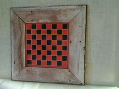 Checkers game board framed in barn wood.