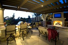 houzz outdoor attached rooms with Fireplace and pools | Outdoor Rooms patio