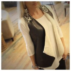 """Aztec trim  black vegan leather Sherpa lined vest Modeling size small. Available in S, M or L. 100% polyester. Bust laying flat: S 18"""" M 19"""" L 20"""" length S 24"""" M 25"""" L 26"""". Please allow me to make you a personal listing. Just comment size needed. All listings should have updated sizes available in the listing. I discount bundles of two+ items.  Please allow me to make your bundle listing for you with your size requests rather than using the feature. FC1001202 Jackets & Coats Vests"""